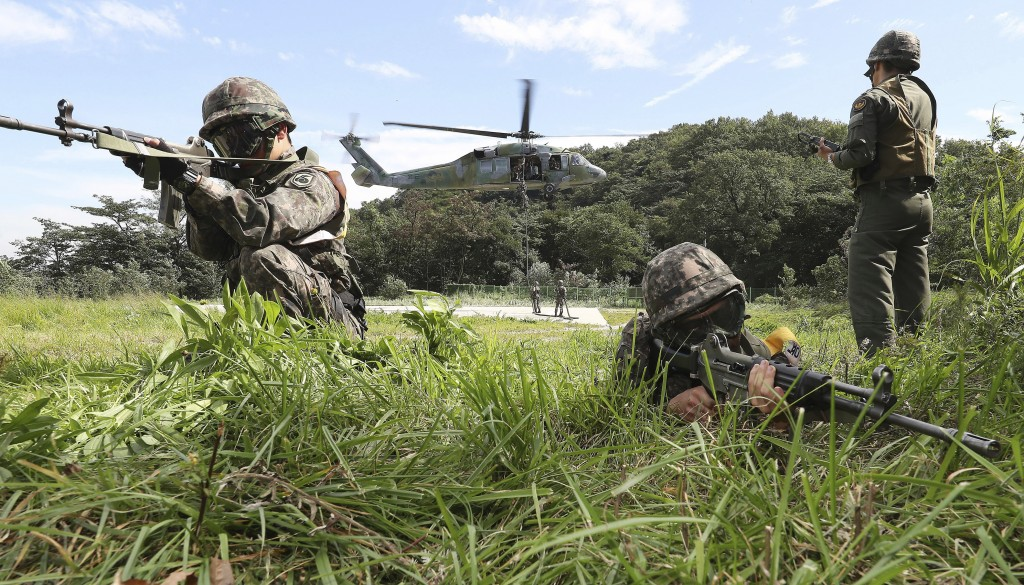FILE - In this Aug. 29, 2017 file photo, South Korean army soldiers aim their machine guns during the annual Ulchi Freedom Guardian exercise in Yongin...
