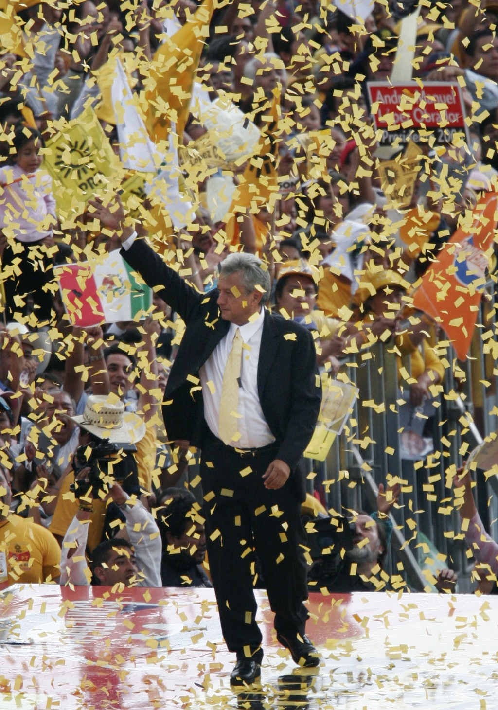 FILE - In this June 28, 2006 file photo, presidential candidate Andres Manuel Lopez Obrador of the Democratic Revolution Party, PRD, waves to supporte...