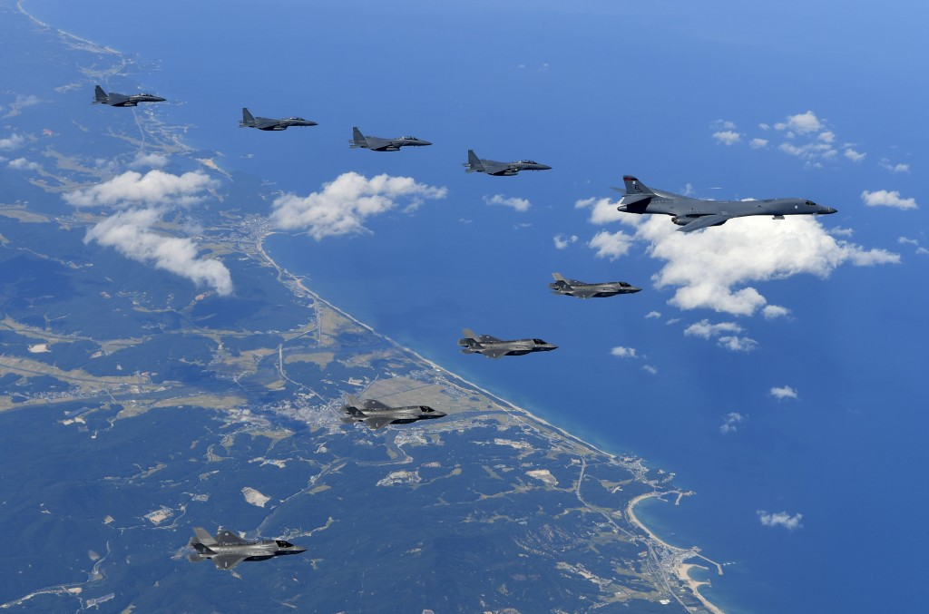 FILE - In this file photo Sept. 18, 2017 provided by South Korea Defense Ministry, U.S. Air Force B-1B bomber, F-35B stealth fighter jets and South Ko...