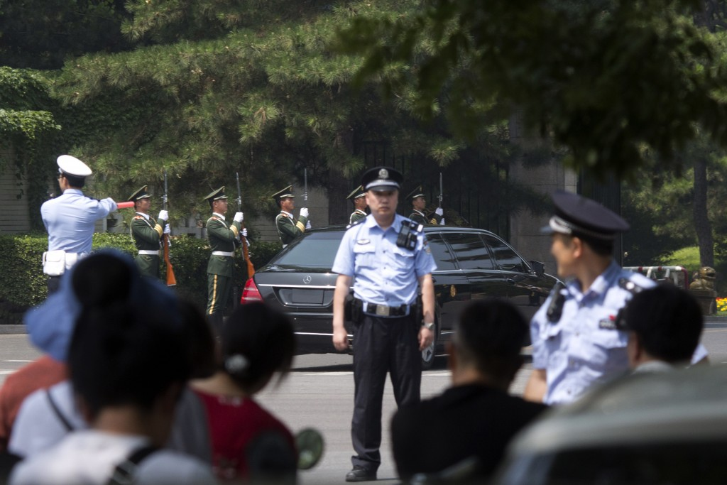 A stretch limousine with a golden emblem similar to one North Korean leader Kim Jong Un has used previously, arrives with motorcycle escorts and guard...