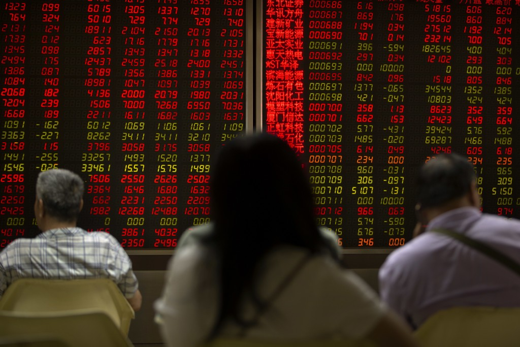Chinese investors monitor stock prices at a brokerage house in Beijing, Friday, June 22, 2018. Asian stocks fell Friday following Wall Street losses o...