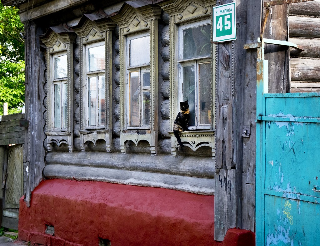 A cat sits at the window of a traditional wooden house in Podolsk near Moscow, Russia, Wednesday, June 20, 2018. During the World Cup, Russia is showi...