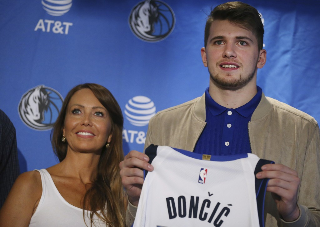 fc00512e7 Mirjam Poterbin stands with her son Luka Doncic after he was introduced to  reporters by the