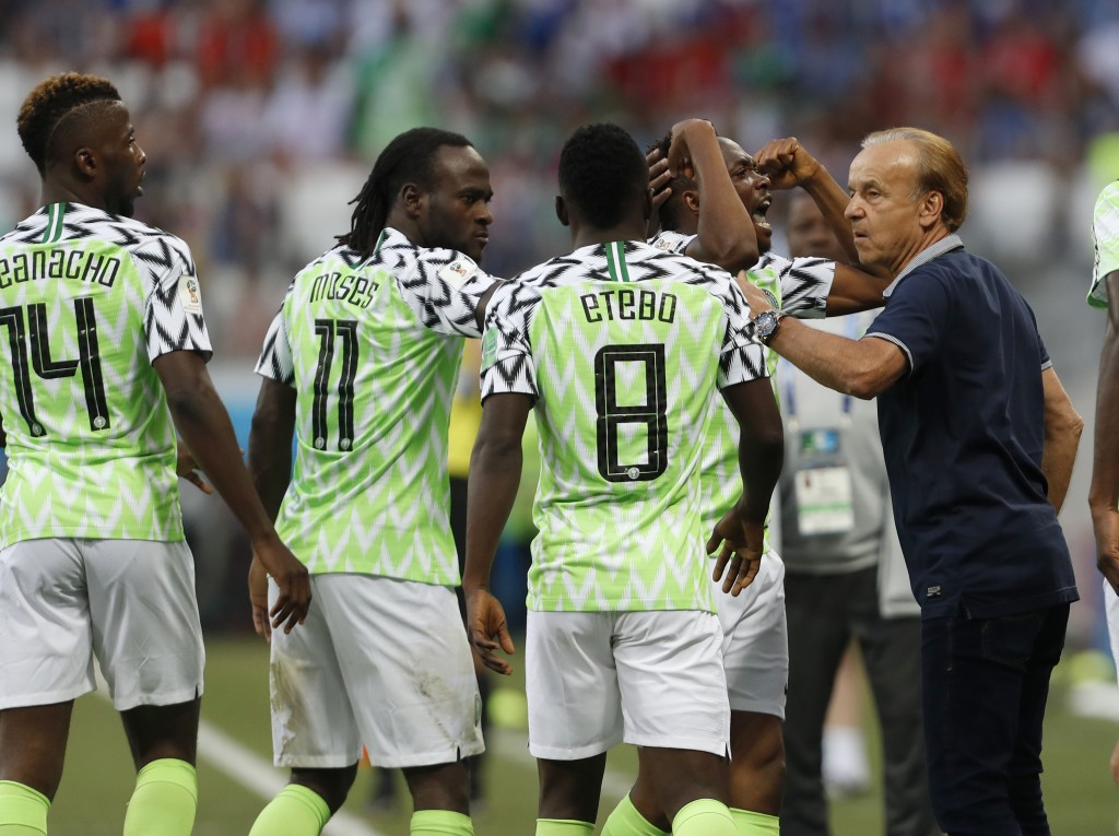 Nigeria head coach Gernot Rohr, right, talks with his players as they celebrate their first goal during the group D match between Nigeria and Iceland ...