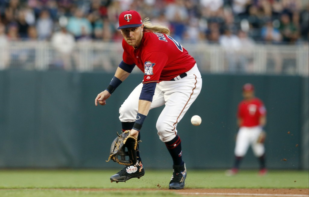 Minnesota Twins third baseman Taylor Motter fields a grounder on a single by Texas Rangers' Elvis Andrus during the fourth inning of a baseball game F...