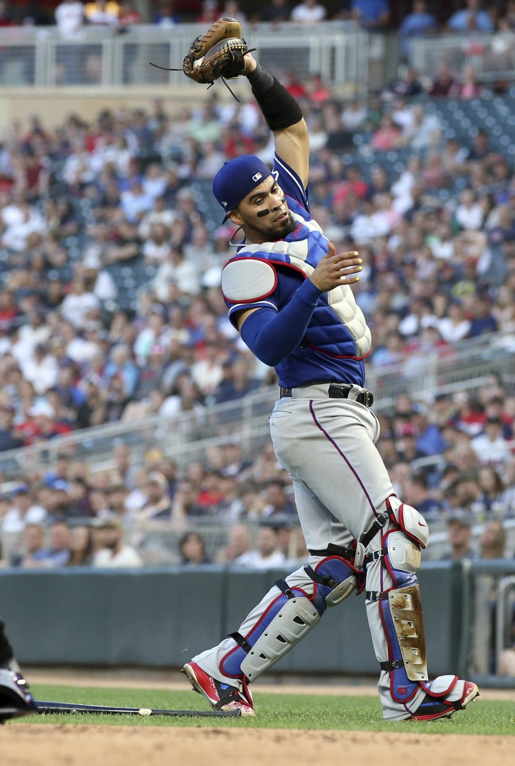 Texas Rangers catcher Robinson Chirinos catches a pop foul by Minnesota Twins' Brian Dozier for an out in the fourth inning of a baseball game Friday,...