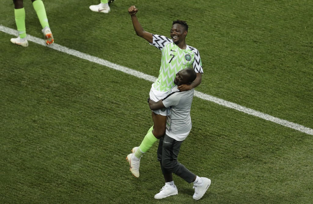 Nigeria's Ahmed Musa celebrates with at the end of the group D match between Nigeria and Iceland at the 2018 soccer World Cup in the Volgograd Arena i...