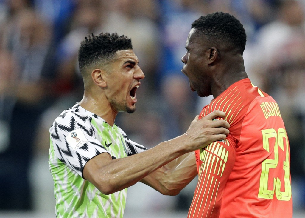 Nigeria's Leon Balogun, left, and Nigeria goalkeeper Francis Uzoho react after Iceland's Gylfi Sigurdsson missed a penalty kick during the group D mat...