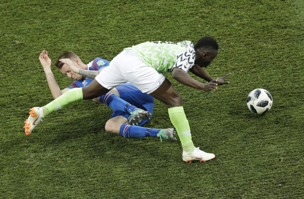 Nigeria's Oghenekaro Etebo, right, fights for the ball with Iceland's Birkir Saevarsson during the group D match between Nigeria and Iceland at the 20