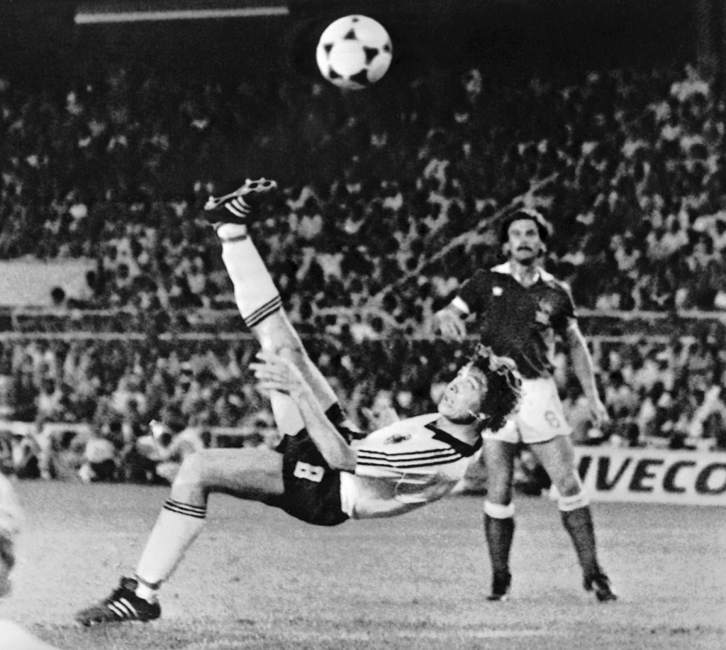 FILE - In this July 8, 1982 file photo, West Germany's Klaus Fischer scores the third goal and equalizes, in the World Cup semifinal soccer match agai...