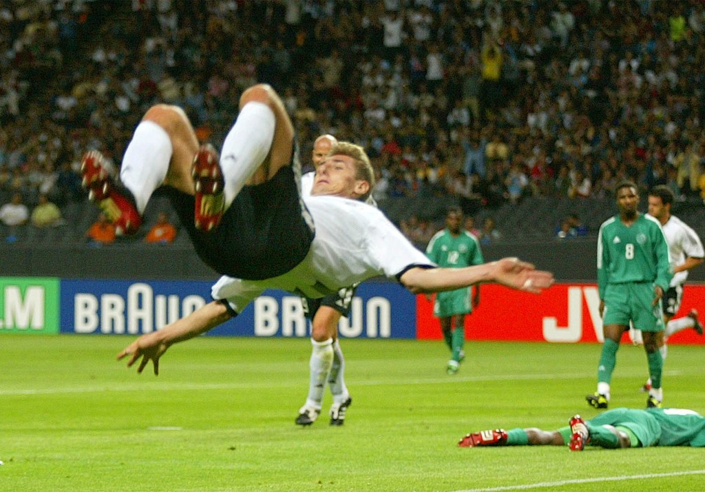 FILE - In this file photo from  June 1, 2002, Germany's Miroslav Klose performs a somersault after scoring his second goal during the 2002 World Cup G