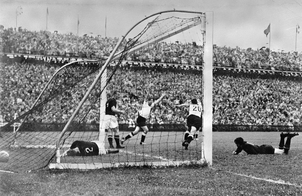 FILE - In this July 4, 1954 file photo, West Germany's Helmut Rahn, center with arms raised, celebrates after equalizing in the World Cup soccer final