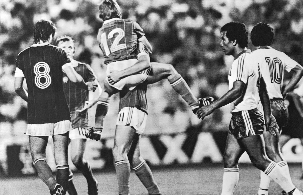 FILE - In this June 15, 1982 file photo, Hungary's Laszlo Fazekas, center, jumps on Gabor Poloskei, after scoring the third goal for his country, duri