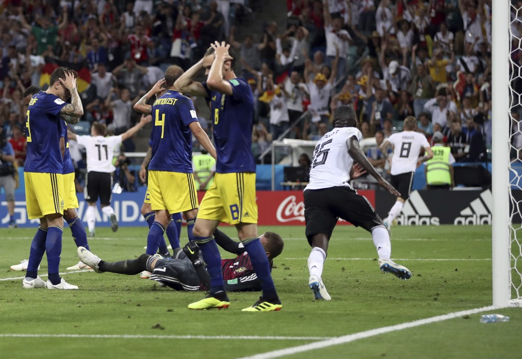 Sweden players reacts after Germany's Toni Kroos, right, scores his side's second goal during the group F match between Germany and Sweden at the 2018