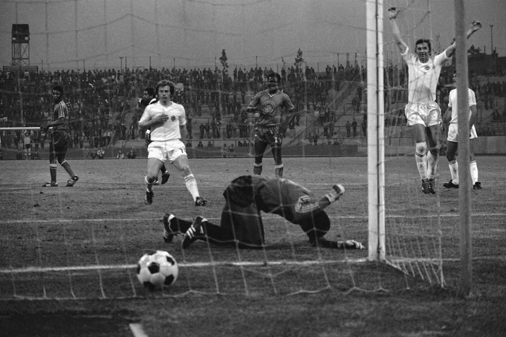 FILE _ In this file photo from  June 18, 1974, Yugoslavia's Branko Oblek jumps for joy, as Zaire's substitute goalkeeper Dimbi Tubilandu beats the gro...