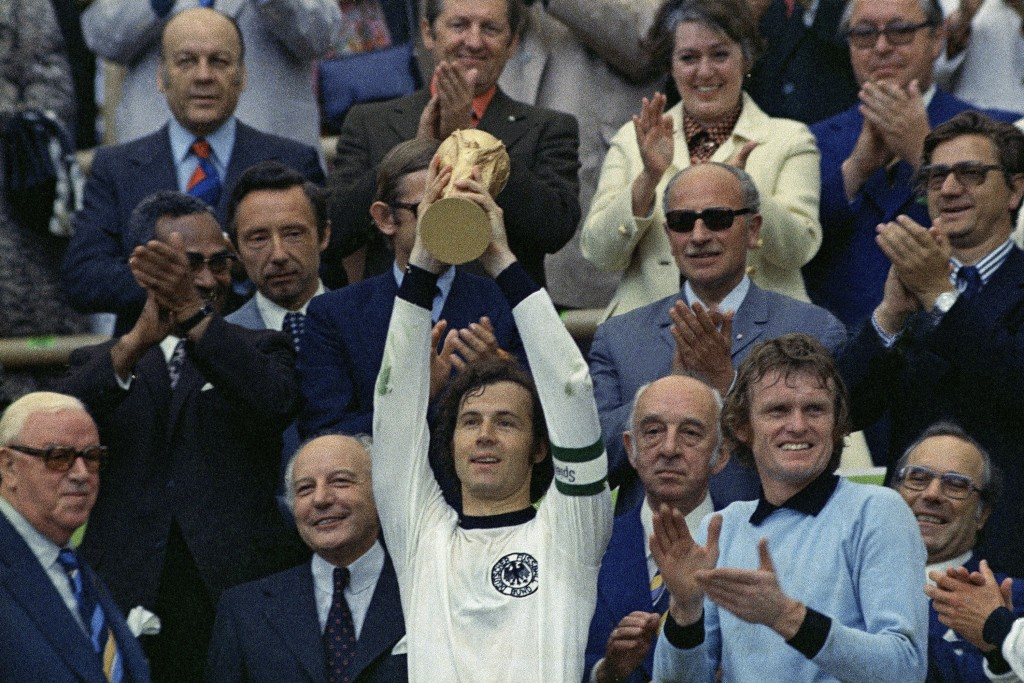 FILE - In this July 7, 1974 file photo, West Germany captain, Franz Beckenbauer holds up the World Cup trophy after his team defeated the Netherlands ...