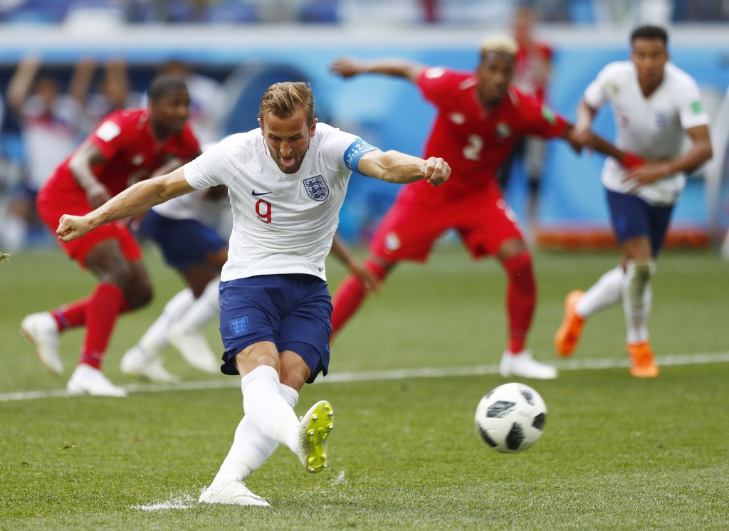 England's Harry Kane kicks a penalty to score his team's second goal during the group G match between England and Panama at the 2018 soccer World Cup ...