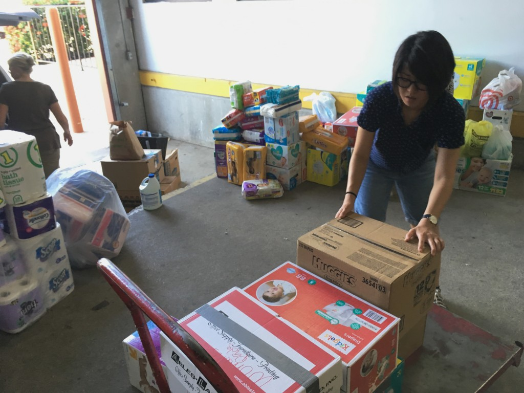 In this photograph taken June 24, 2018, Catholic Charities of the Rio Grande Valley volunteer Veronica Yoo loads boxes of donations on to a cart at a ...