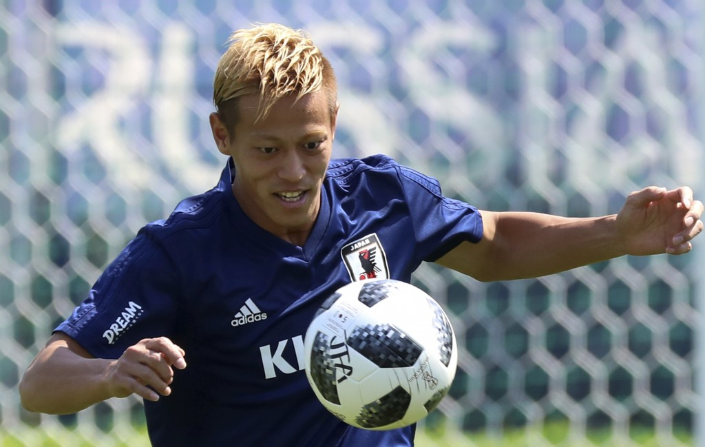 Japan's Keisuke Honda warms up during a training session of Japan national team at the 2018 soccer World Cup in Kazan, Russia, Tuesday, June 26, 2018....