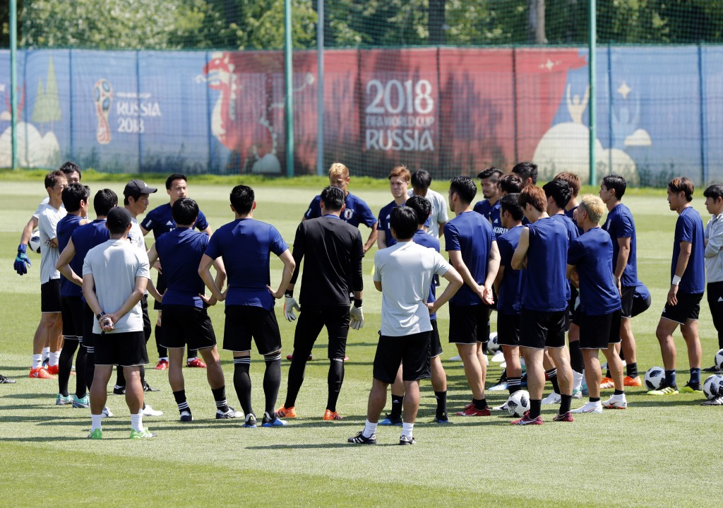 Players listens Japan's head coach Akira Nishino during a training session of Japan national team at the 2018 soccer World Cup in Kazan, Russia, Tuesd...