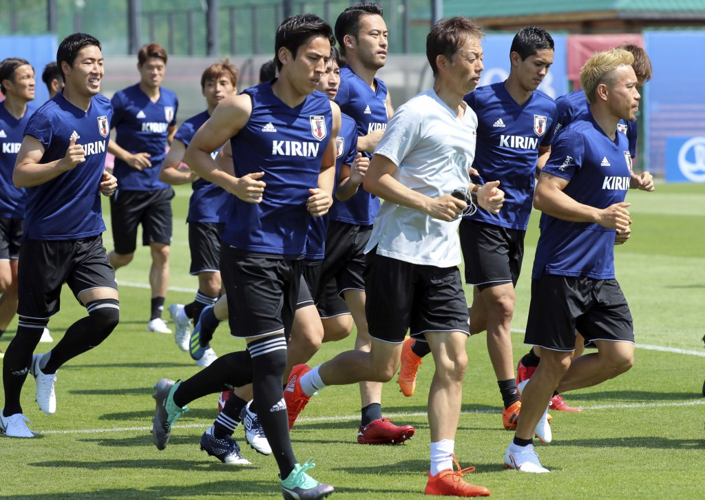 Players warm up during a training session of Japan national team at the 2018 soccer World Cup in Kazan, Russia, Tuesday, June 26, 2018. (AP Photo/Euge...