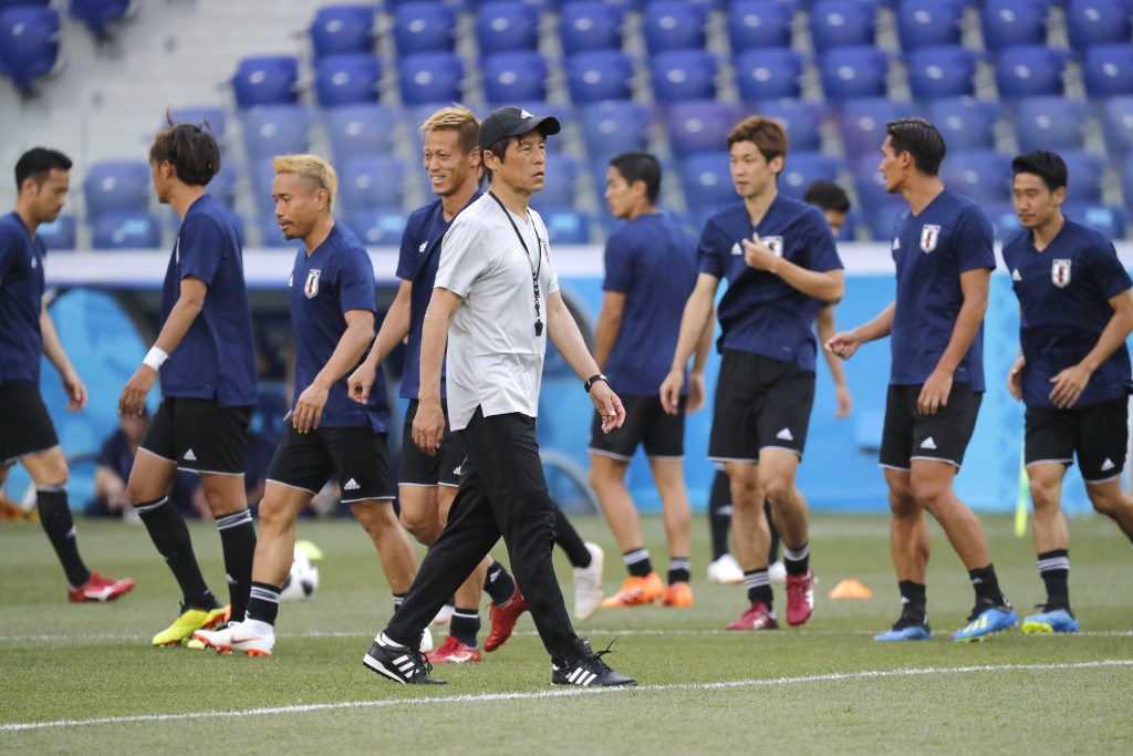 Japan's players warm up during the Japan's official training on the eve of the group H match between Poland and Japan at the Volgograd Arena the 2018