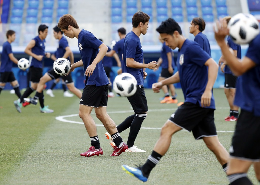 Japan's players warm up during the Japan's official training on the eve of the group H match between Poland and Japan at the Volgograd Arena the 2018 ...