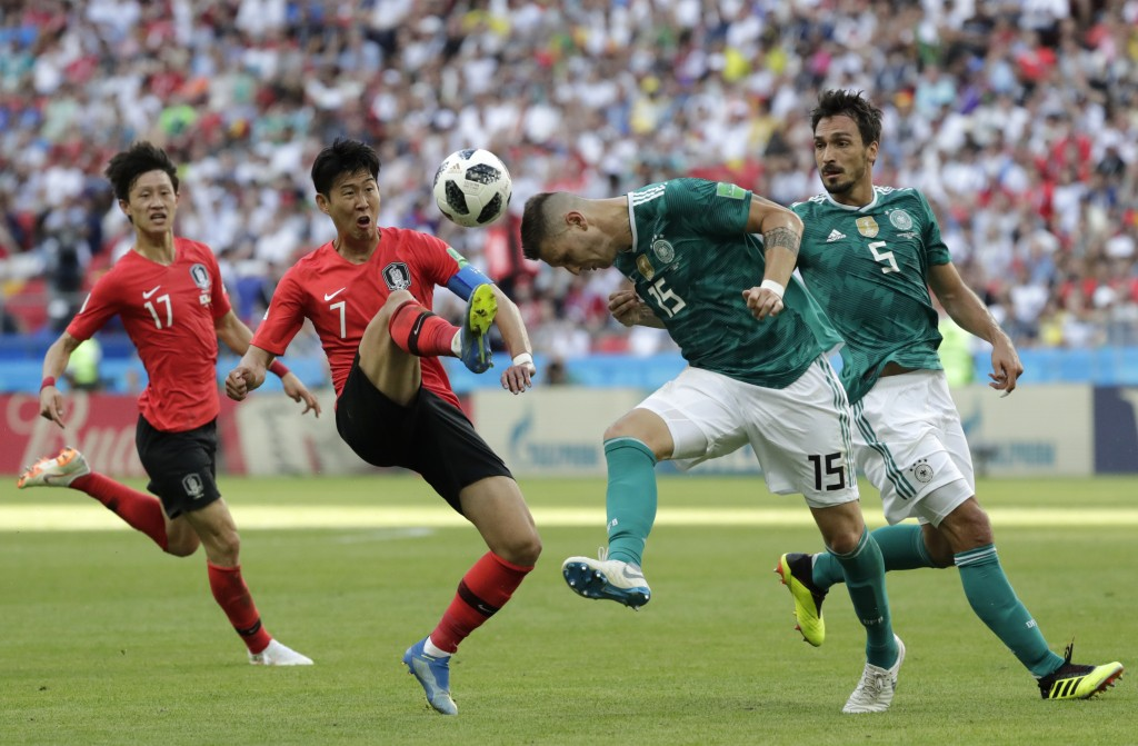 South Korea's Son Heung-min, 2nd left, challenges for the ball Germany's Niklas Suele, 2nd right, during the group F match between South Korea and Ger...