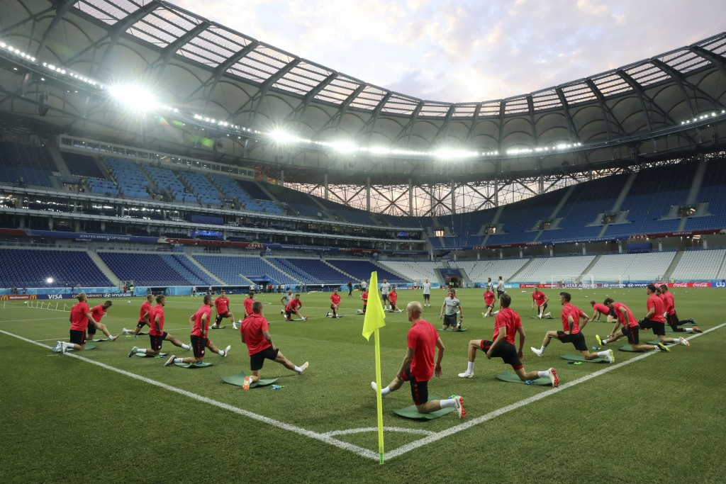Players warm up during Poland's official training on the eve of the group H match between Poland and Japan at the Volgograd Arena during the 2018 socc...