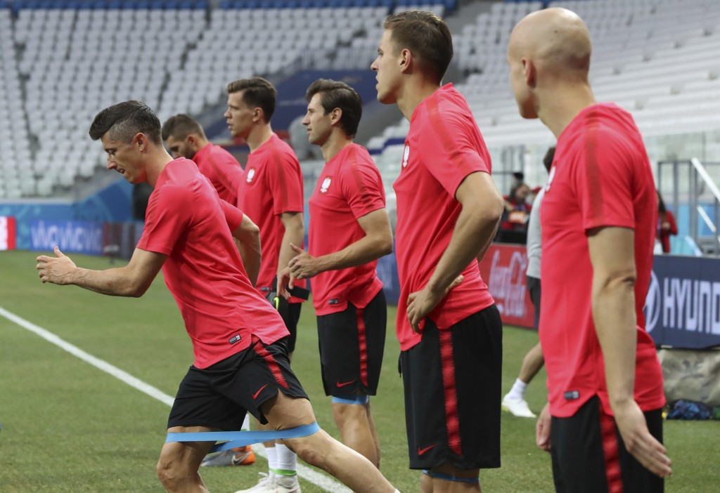 Players warm up during Poland's official training on the eve of the group H match between Poland and Japan at the Volgograd Arena during the 2018 socc