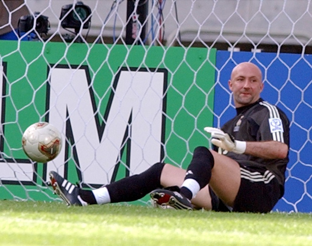 FILE - In this Tuesday, June 11, 2002 file photo, France's goalkeeper Fabien Barthez sits on the ground with the ball in the net after Denmark scored ...