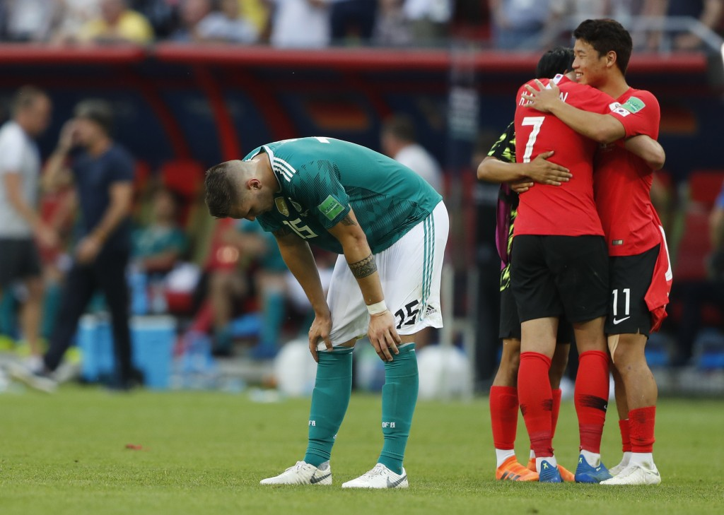 Germany's Niklas Suele, left, is dejected as South Korea's Son Heung-min, right, celebrates after the group F match between South Korea and Germany, a...