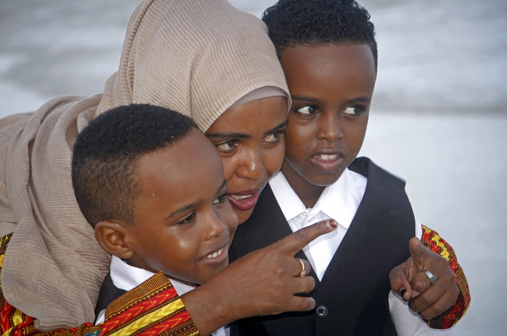 Maryan Abdullahi, who had been hoping to go to neighboring Ethiopia where their U.S. travel plans were to have been processed, walks with her two sons...