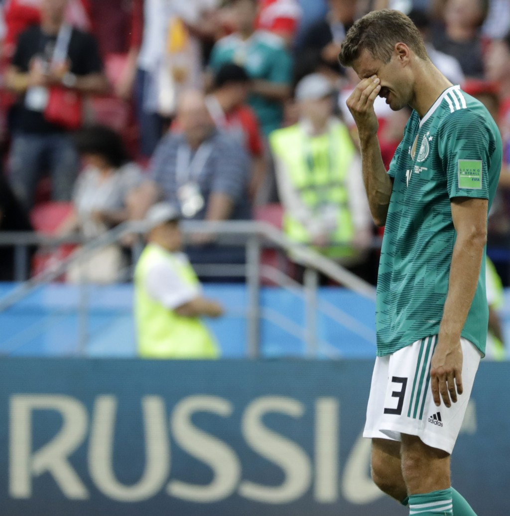Germany's Thomas Mueller wipes his face after the group F match between South Korea and Germany, at the 2018 soccer World Cup in the Kazan Arena in Ka...