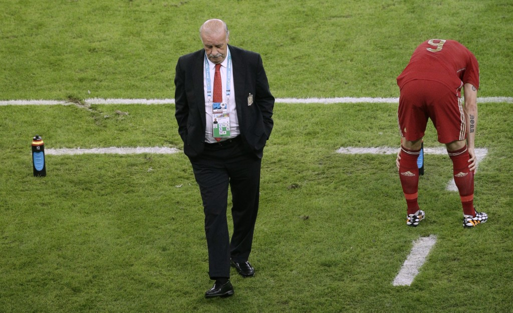 FILE - In this Wednesday, June 18, 2014 file photo, Spain's head coach Vicente Del Bosque in his coaching area during the World Cup soccer match betwe...
