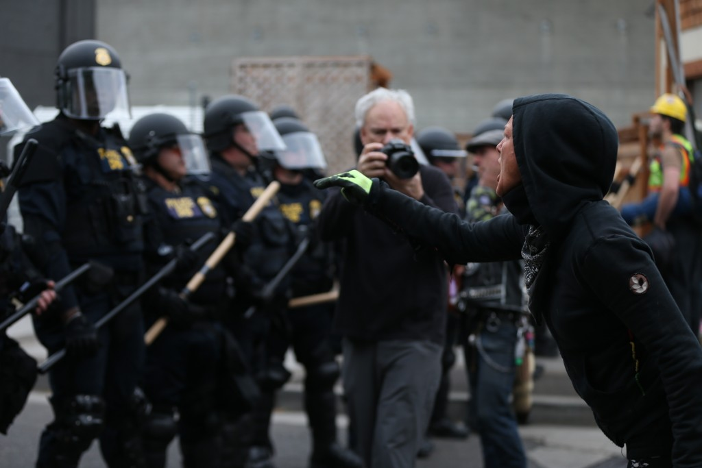 Authorities take action to reopen Portland's Immigration and Customs Enforcement headquarters early Thursday, June 28, 2018 in Portland, Ore. Federal ...