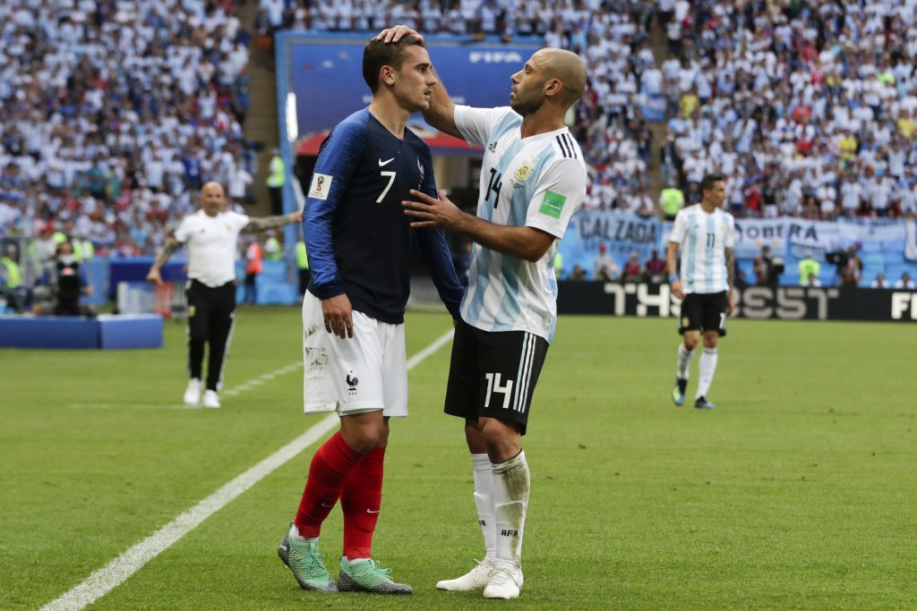 Argentina's Javier Mascherano, right, talks to France's Antoine Griezmann, left, during the round of 16 match between France and Argentina, at the 201...