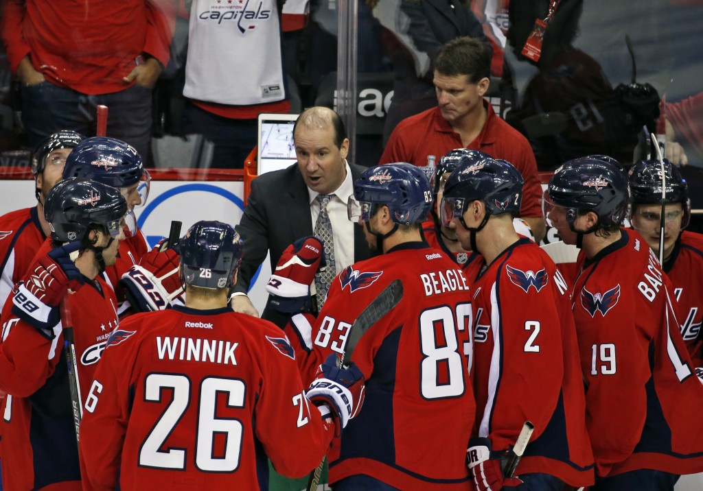 FILE - In this April 14, 2016, file photo, Washington Capitals assistant coach Todd Reirden talks with the team during a timeout in the third period o...