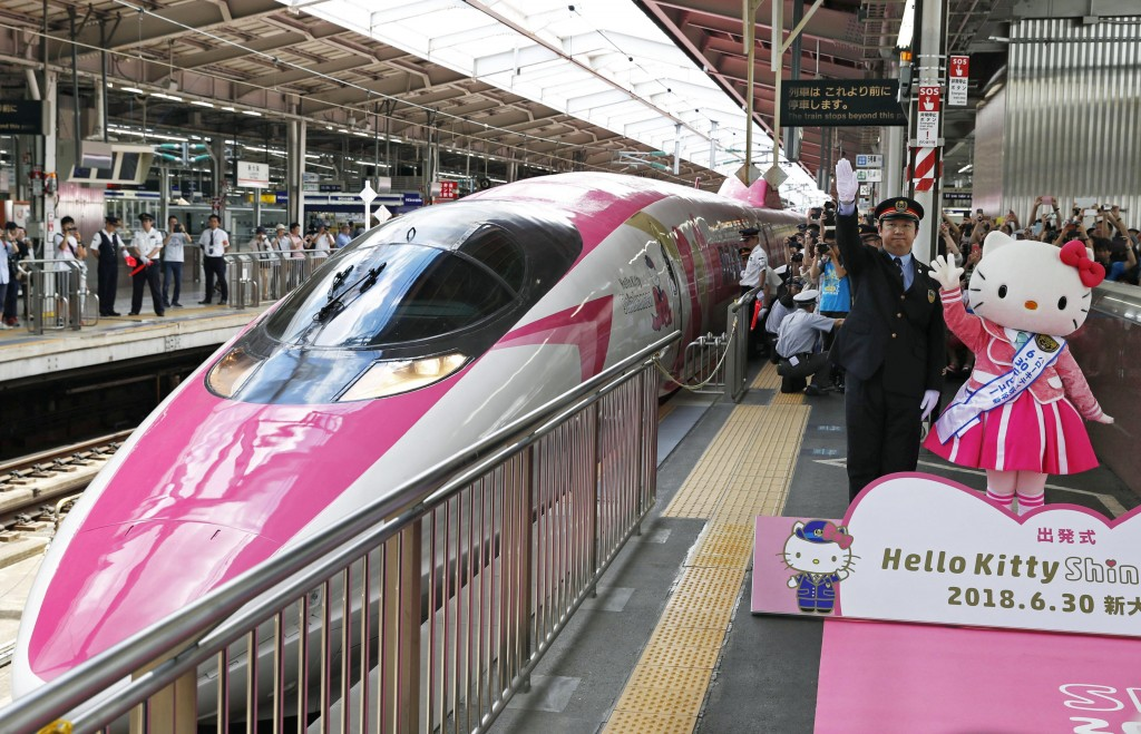 "A Hello Kitty-themed ""shinkansen"" bullet train is unveiled at JR Shin Osaka station, in Osaka, western Japan, Saturday, June 30, 2018.  The special sh..."
