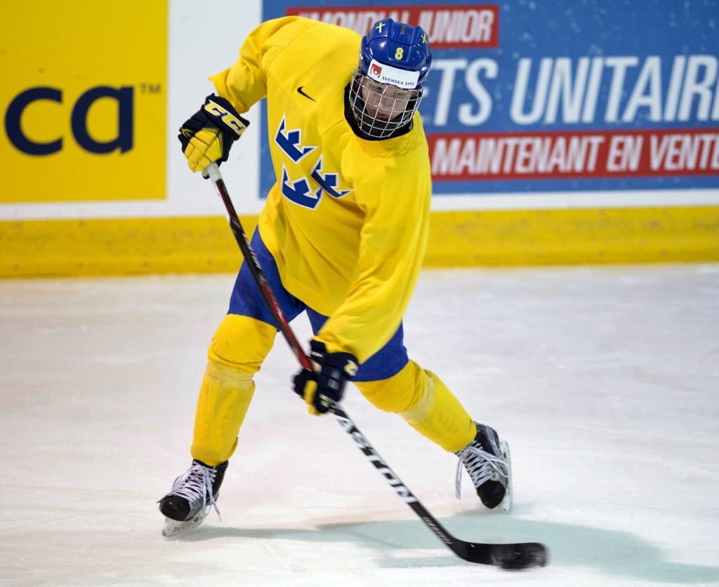FILE - In this Jan. 3, 2017, file photo, Sweden's Rasmus Dahlin (8) works on his shot during practice at the world junior ice hockey championships in