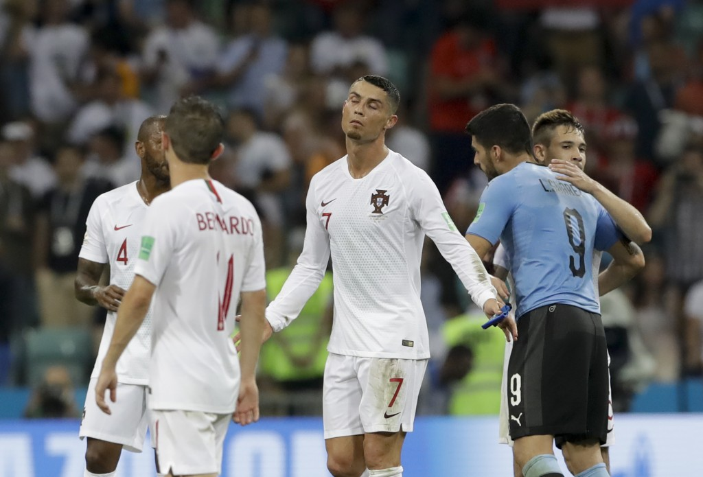 Portugal's Cristiano Ronaldo, center, reacts after the round of 16 match between Uruguay and Portugal at the 2018 soccer World Cup at the Fisht Stadiu...
