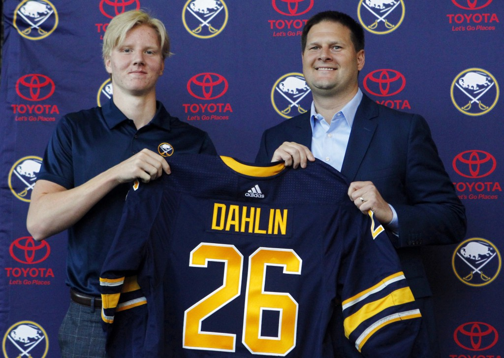 FILE - In this Monday, June 25, 2018, file photo, Rasmus Dahlin, left,  of Sweden, the Buffalo Sabres No. 1 pick in the NHL hockey draft  poses with S