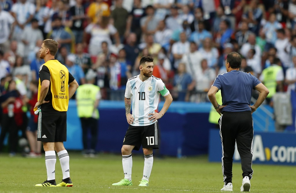 Argentina's Lionel Messi, center, stands at the end of the round of 16 match between France and Argentina, at the 2018 soccer World Cup at the Kazan A...