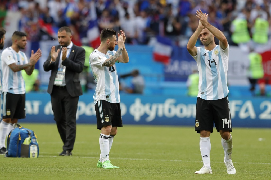Argentina's Lionel Messi, center, and Argentina's Javier Mascherano, right, acknowledge the fans at the end of the round of 16 match between France an