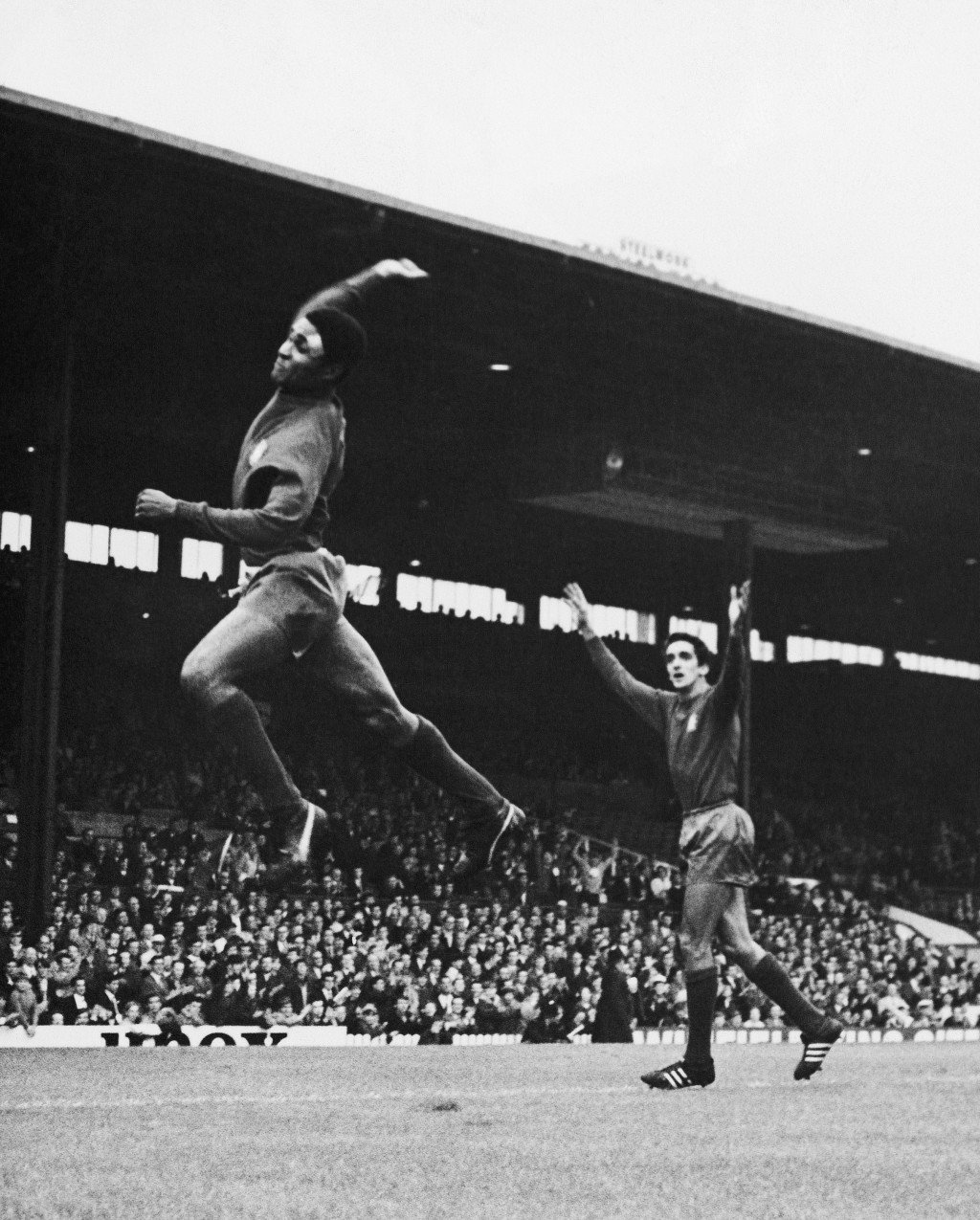 FILE - In this July 16, 1966 file photo, Eusebio jumps high after scoring Portugal's second goal in their World Cup soccer match against Bulgaria in M