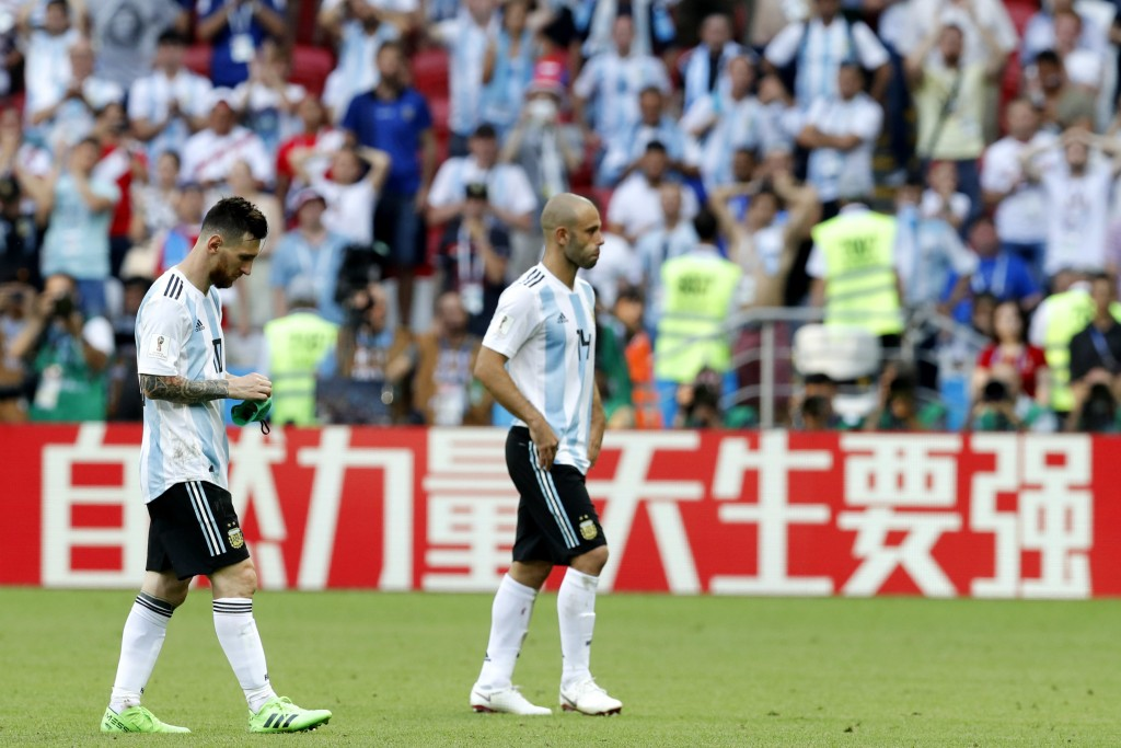 Argentina's Lionel Messi, left, and Argentina's Javier Mascherano leave the field after the round of 16 match between France and Argentina, at the 201