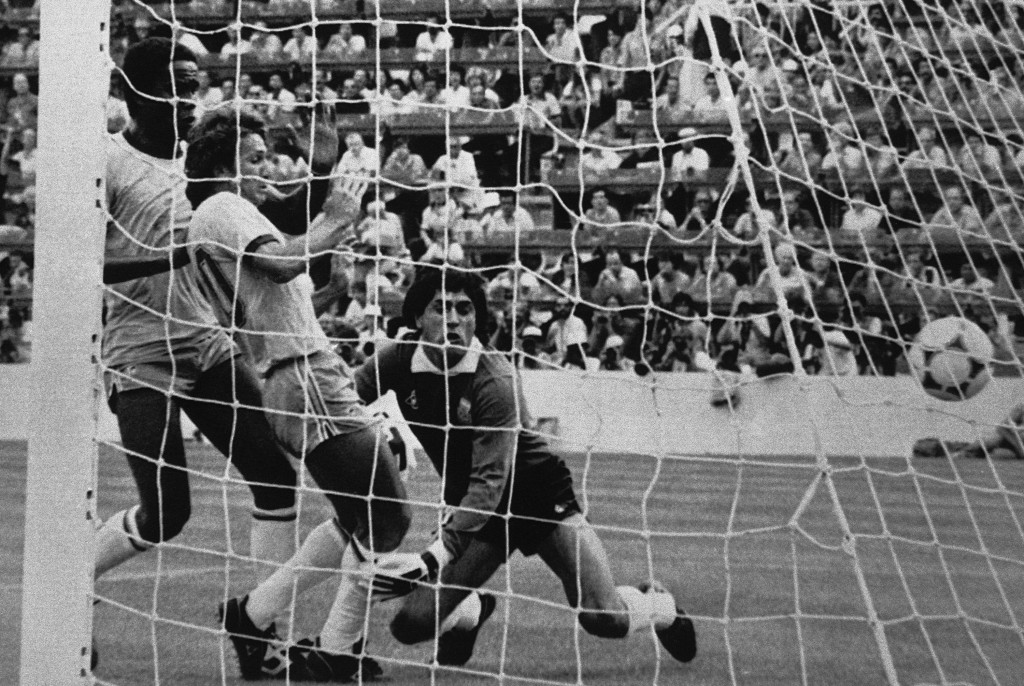 FILE - In this July 2, 1982 file photo, Brazil's Zico center, scores during a World Cup soccer match against Argentina, which Brazil won 3-1, at the S...