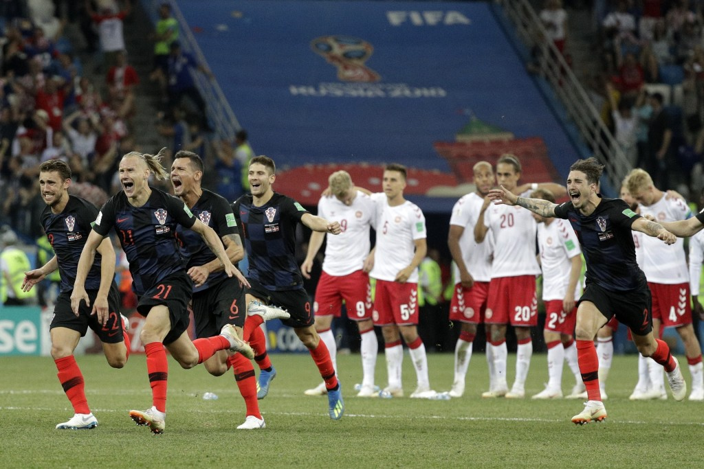 Croatians players celebrate after the penalties during the round of 16 match between Croatia and Denmark at the 2018 soccer World Cup in the Nizhny No
