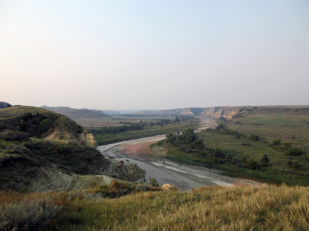 This Sept. 3, 2017 photo shows a curving river at Theodore Roosevelt National Park in Medora, N.D., marking the landscape in colorful patterns as it i...