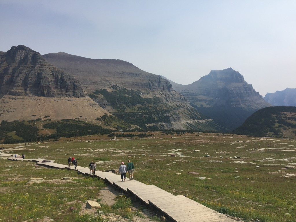 This Sept. 4, 2017 image shows hikers on the Hidden Lake trail in Glacier National Park in Montana. The trail takes visitors through a broad alpine va...